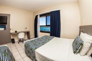 Executive Triple Room with Side Sea View