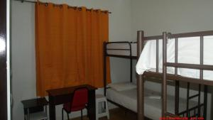 Bed in 4-Bed Female Dormitory Room with External Bathroom