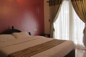 Royal Castle Service Apartment, Апартаменты  Nedumbassery - big - 32