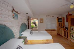 Two Double Beds with Patio and Garden View