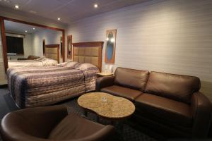 Standard Room with Queen Bed and Sofa
