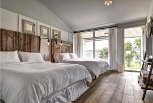 Deluxe Queen Room with Two Queen Beds and Balcony