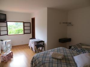 Triple Room with 1 Double Bed and 2 Single Beds