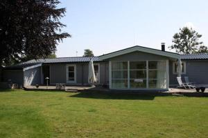 Three-Bedroom Holiday home in Kirke Hyllinge 2, Case vacanze  Kirke-Hyllinge - big - 1