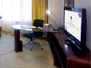 Suite Executive con cama grande (2 adultos)