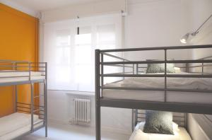 Bed in 4-Bed Dormitory Room with Shower