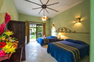 Deluxe Double Room with Two Queen Beds and Pool View