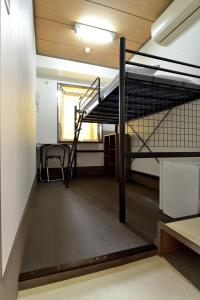 Single Room with High-Bed and Shared Bathroom