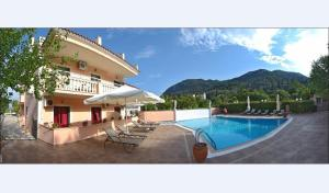 Photo of Apartments Corfu Sun Pool Side