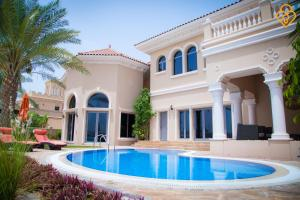 KeysPlease-Luxury 7 Bedroom Palm Villa with Private Beach