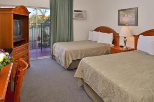 Standard Room with Two Double Beds - Smoking (Weekly Rate)