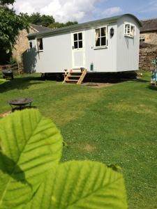 Posh Huts Farmstay in Falstone, Northumberland, England