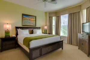 One King & One Queen Suite with Sofa Bed and Golf Course View