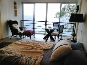 Double Room with Two Double Beds with Private Bathroom - Sea View