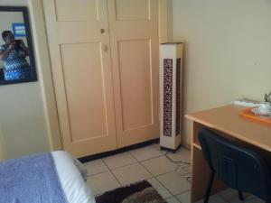 Nzipile Executive Guest House, Bed & Breakfasts  Chingola - big - 14