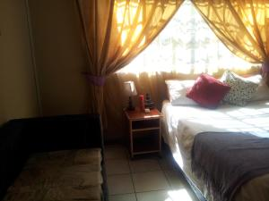 Nzipile Executive Guest House, Bed & Breakfasts  Chingola - big - 13