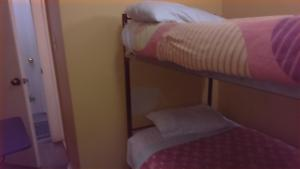 Bed in 8-Bed Male Dormitory Room with private bathroom