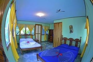 Standard Room with Garden View (1-4 Adults)