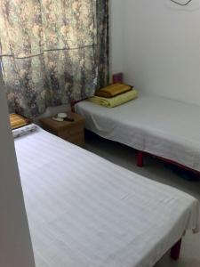 Alan's Guesthouse, Privatzimmer  Qinhuangdao - big - 1