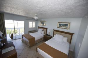 Two Double Beds Room Ocean Front with Private Balcony