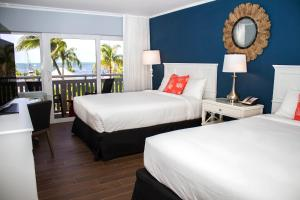 Queen Room with Two Queen Beds - Gulf View and Balcony