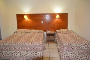Two connecting double rooms (6 Adults)