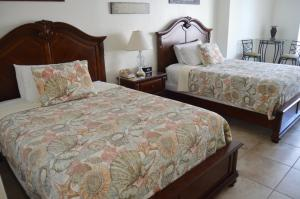 Queen Room with Two Queen Beds - Partial Ocean View
