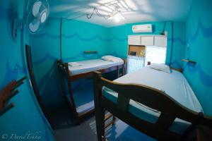 Bed in 4-Mixed Dormitory Room With Air Conditioning