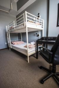 Twin Bunk Room with Shared Bathroom
