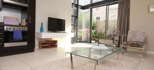 Two-Bedroom Apartment with private Garden and Pool