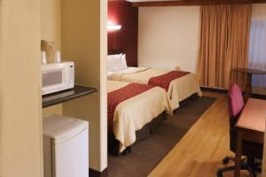 Deluxe Double Room with Two Double Beds Disability Access with Roll In Shower Non-Smoking