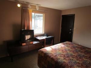 Economy Queen Studio - 208  (Not Pet Friendly Room)