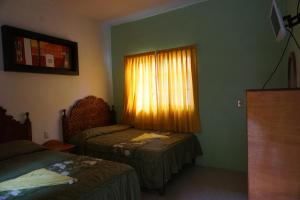 Double Room with Two Double Beds - Interior View
