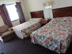 Room with two full size beds