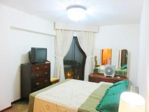 Photo of En Suite Bedroom With Gym In Miraflores