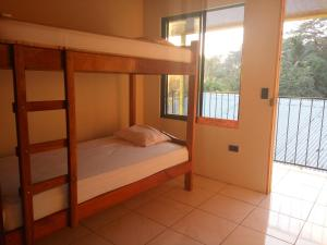Bed in 4-Mixed Dormitory Room With Private Bathroom