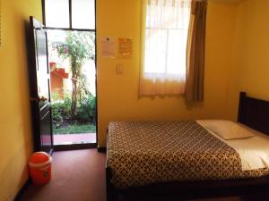Single Bed in Male Dormitory Room with Shared Bathroom
