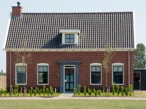 Holiday Home 10p. Wellnesswoning, Holiday homes  Colijnsplaat - big - 2