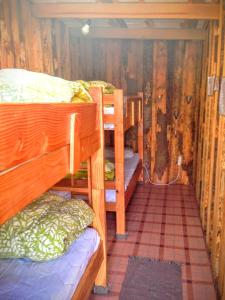 Bed in 4-Bed Dormitory Room with External Shared Bathroom