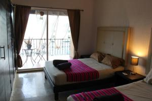 Deluxe Double Room with Two Double Beds- with Balcony and Jacuzzi
