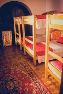 Bed in 6-Bed Dormitory Room with Shared Bathroom