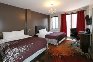 Superior Room with One Queen and One Double Bed and Balcony