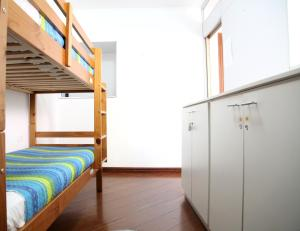 Bed in 4-Bed Female Dormitory Room with Shared Bathroom