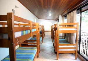 Bed in 10-Bed Male Dormitory Room with Shared Bathroom