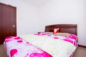 Qingdao Golden Beach Sihaiju Seaview Apartment Diwei Garden Branch, Apartmány  Huangdao - big - 6