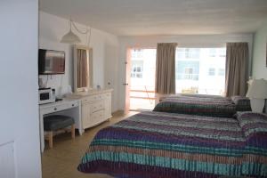 Deluxe Room with Two Queen Beds and Balcony and Sea View