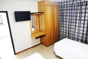 Quadruple Room with Single Beds