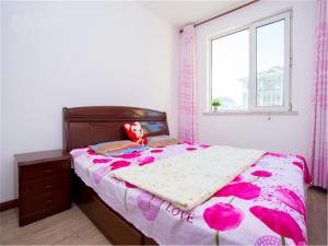 Qingdao Golden Beach Sihaiju Seaview Apartment Diwei Garden Branch, Apartmány  Huangdao - big - 21