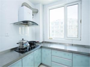 Qingdao Golden Beach Sihaiju Seaview Apartment Diwei Garden Branch, Apartmány  Huangdao - big - 15