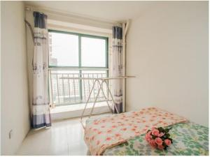 Qingdao Golden Beach Sihaiju Seaview Apartment Hai'an Fengqing Branch, Ferienwohnungen  Huangdao - big - 4